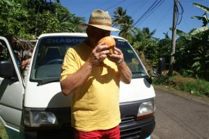 Bill drinking from a fresh coconut