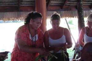 Mama teaching Susan how to make a flower crown