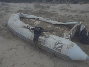 Our poor dinghy washed up on the beach