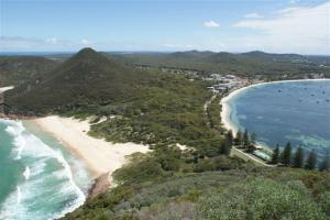 One mile beach on the left and Shoal bay on the right