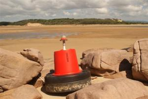 Misplaced buoy on the beach on the other side