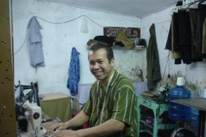 One of the workers in the sewing rooms