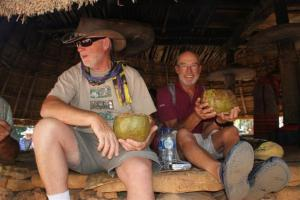 Bill and Norman drinking from the coconuts