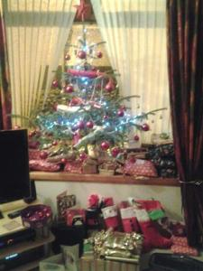 The Christmas tree surrounded with presents