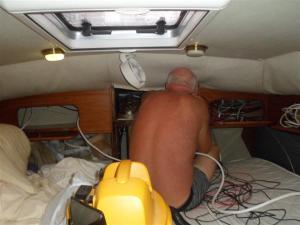 Bill working in the aft cabin with more wires