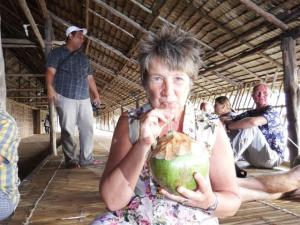 Drinking from a fresh coconut