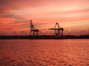Pink glow over the container port