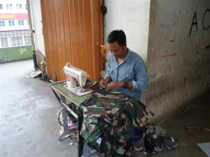 One of many workers sewing