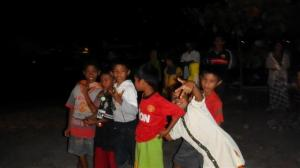 The local kids watched us all dancing.
