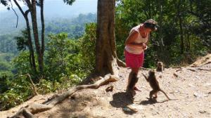 Sue feeding monkeys with beautiful view across the valley
