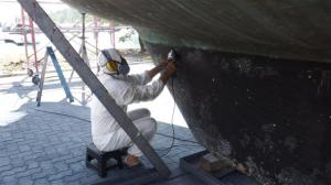 Bill sanding down the old antifoul on the keel