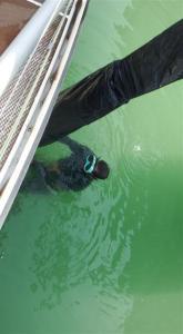 Diver adjusting strops