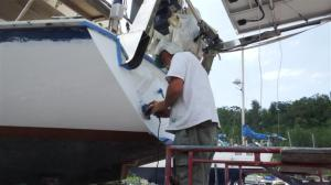 Bill rubbing down the transom again