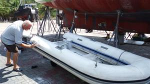 The dinghy with glued neoprene strips on