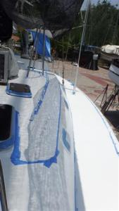 Newly painted decks with all the blue masking tape over everything