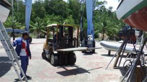 The forklift places the rudder in position