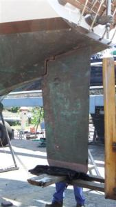 The forklift pushes the rudder right up