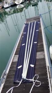 The sail bag laid out on the pontoon