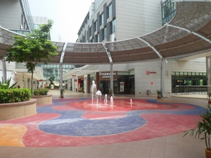 Starbucks in the Puteri mall with the water sculpture in front of it
