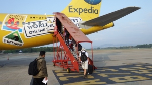 Bill boarding our bright yellow plane