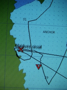 Our anchorage. Our position by the cross. The triangle is boat waypoint from last year