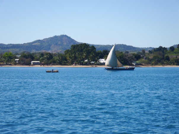 A pirogue sailing up the channel
