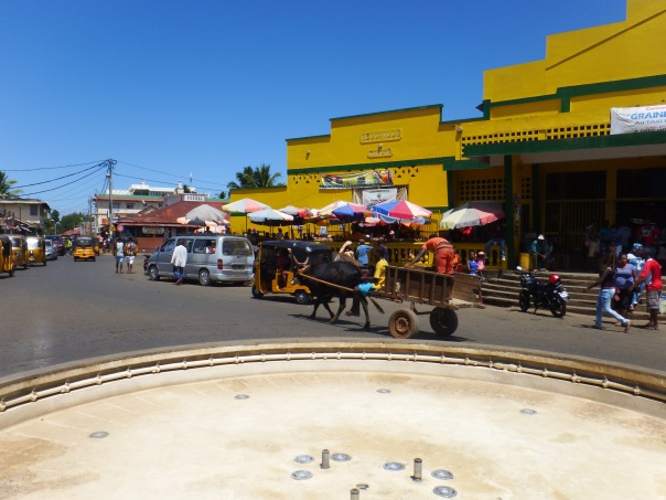 Street life with the market on the right and a roundabout in front of me